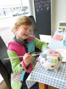 Isa - age 6 painting her money box